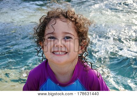 Cheeky Girl Smile In Swimming Pool