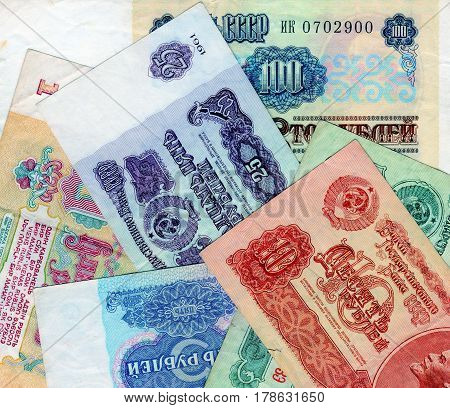 Banknotes of the USSR - one, three, five, ten, twenty-five, one hundred. Closeup. Collection. Background with money signs.