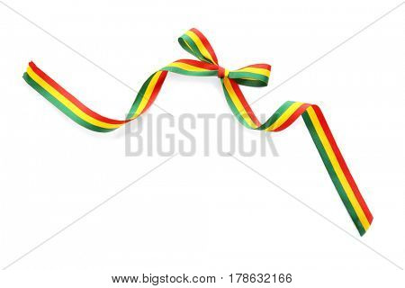 Ribbon bow in colors of Bolivian flag on white background