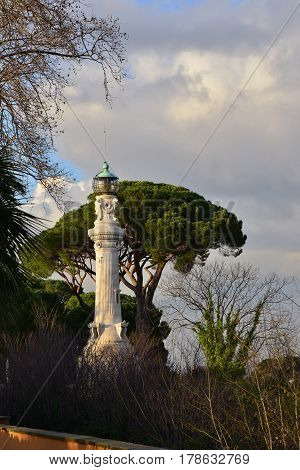 Sunset over old lighthouse in Rome at the top of Gianicolo Hill completed in 1911