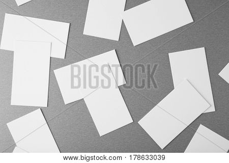 Blank paper cards for branding on grey background