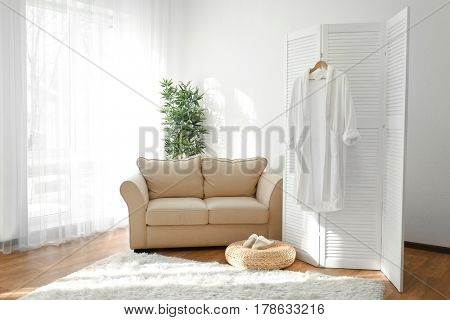 Light room interior with folding screen