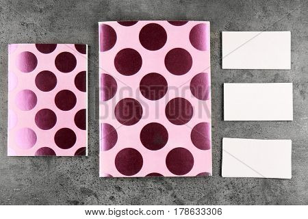 Two notebooks and business cards on grunge background