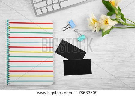 Stationery and business cards on wooden table