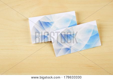 Blank paper cards for branding on wooden background