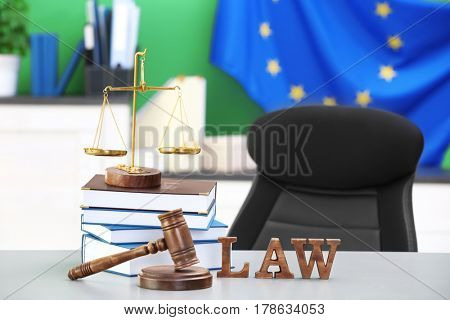 Judge gavel with scales and books on table