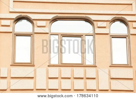 Modern building with arched brown windows