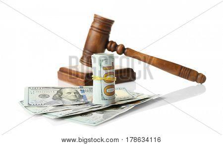 Money and judge's gavel on white background