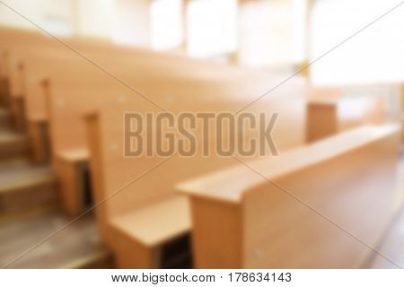 Interior of big modern classroom, blurred view