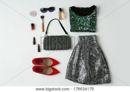 Set of stylish clothes and accessories for woman on white background