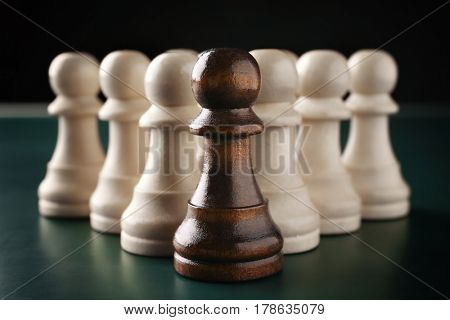 Boss vs Leader concept. Chess pieces on dark background