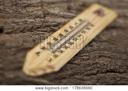 Thermometer On A Old Wooden Background Photo Blur Effect