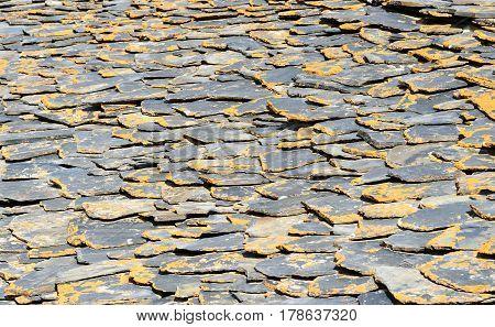 Roof built from shale stones. Background texture. Shenako village in Tusheti region. Georgia