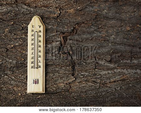Thermometer On A Old Wooden Background Photo