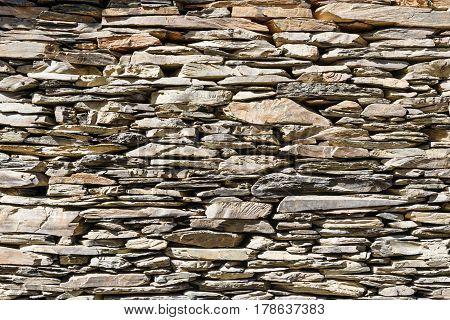 Wall built from shale stones. Background texture. Shenako village in Tusheti region. Georgia