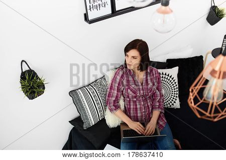 Young freelancer woman using laptop.Happy smiling girl working on line.Work at home.Studying and learning using notebook computer.Enjoy working.Freelance workbusiness people concept.Home office