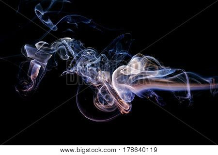 Abstract art. Color lilac blue smoke from the aromatic sticks on a black background. Background for Halloween. Texture fog. Design element. The concept of aromatherapy.