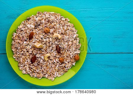 Muesli With Nuts(hazelnuts,  Almonds,cashew). Muesli On A Wooden Table. Muesli Top View . Healthy Fo