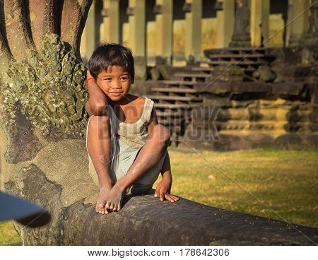 Siem Reap, Cambodia - Circa December 2011 - Portrait shot of a cambodian boy in Angkor Wat complex