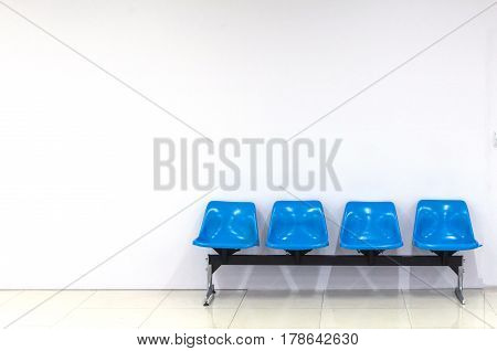 empty blue seats interior building with white wall