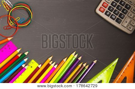 School Supplies (pencil, Pen, Ruler, Triangle) On Blackboard Background Ready For Your Design .schoo