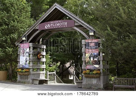 Plimoth Plantation, Plymouth, Massachusetts - September 10, 2014 -- The Welcome Center arched entrance at Plimoth Plantation surrounded by trees and foliage on a bright sunny day in September.