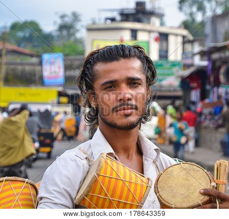 Munnar, Kerala, India _ Circa November 2012 - Portrait of unidentfied Indian man as a street musician with his bongo drums