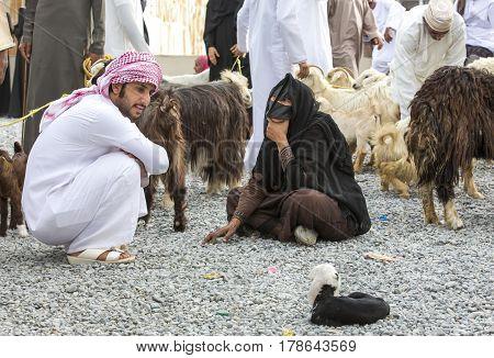 Nizwa Oma 24th March 2017: omani couple talking at the Nizwa Habta market