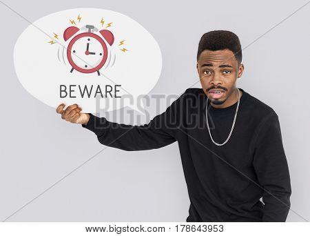 African man holding speech bubble alarm clock icon