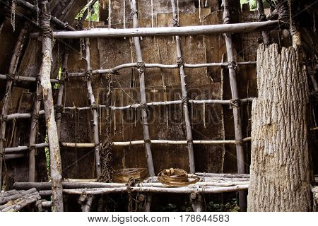 Close up view of the interior of a Wampanoag Indian hut made of branches and covered in vibrant bark in the Wampanoag Indian Village at Plimoth Plantation, Plymouth, on a bright sunny day in September.