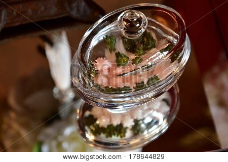 Glass of confectionery tableware on the table