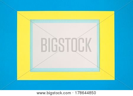 Vertical composition with white, blue and yellow sheets