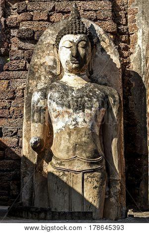 Sculpture buddha damage with light and shadow at Wat Phra Si Ratanamahathat in Sisatchanalai Historical Park Sukhothai province Thailand