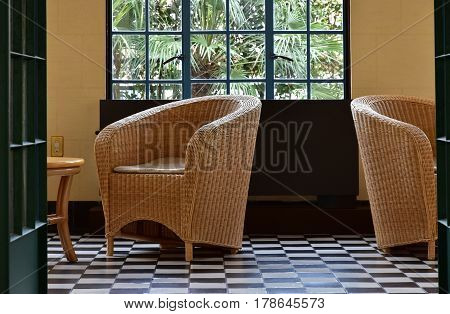 Rattan chair in the room and the landscape of the window