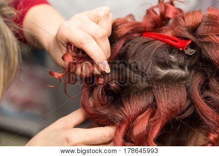 curls of hair in a beauty salon .