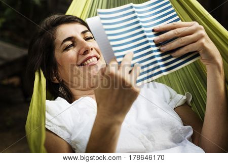 Adult Woman Reading Book on Hammock