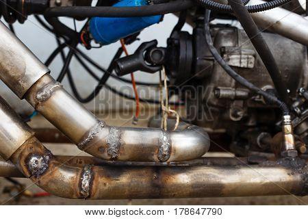 Welded seams on steel exhaust pipe in motorcycle. Customizing repair