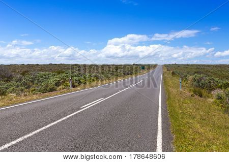 Long road and blue sky in summer, Victoria Australia.