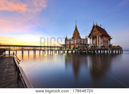 Wat Hong Thong (golden swan) a Thai temple that is built into the sea. At Chachoengsao Thailand.