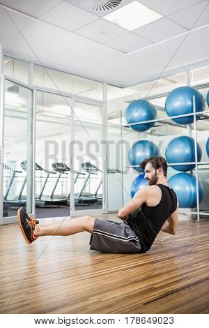 Man doing exercise with medicine ball in the studio