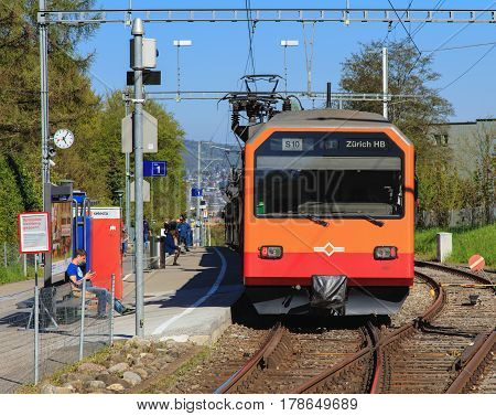 Zurich, Switzerland - 20 April, 2016: a train of the Uetliberg railway line at the platform of the Triemli station. The Uetliberg railway line is a passenger railway line from the Zurich main railway station to the summit of the Uetliberg mountain.