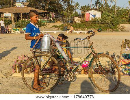 Arambol Beach, Goa, India - February 23, 2017: Boy With Bicycle At Flea Market On Arambol Beach At S