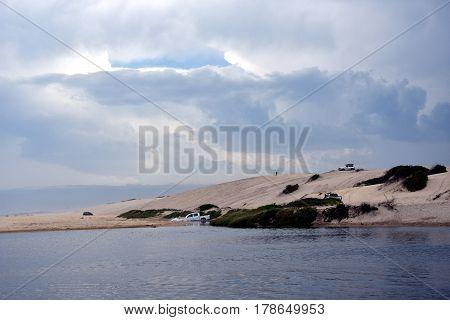 Crokers creek with sand dunes in the background (Belmont - Nine Miles - Beach NSW Australia).