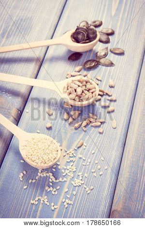 Vintage Photo, Sunflower, Pumpkin And Sesame Seeds On Wooden Boards, Healthy Nutrition Concept