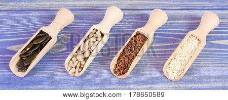 Linseed, Sunflower, Pumpkin And Sesame Seeds On Wooden Boards, Healthy Nutrition Concept