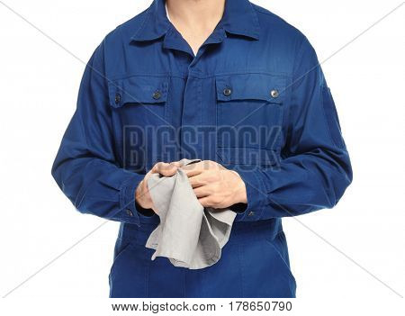 Auto mechanic in uniform on white background, closeup
