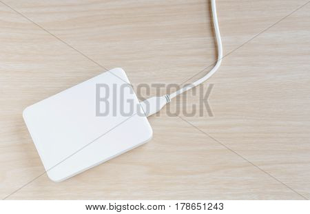 White external hard drive for backup and storage data on nature wood background