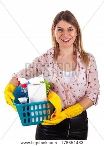 Picture of a smiling beautiful woman holding a box of cleaning supplies on an isolated background