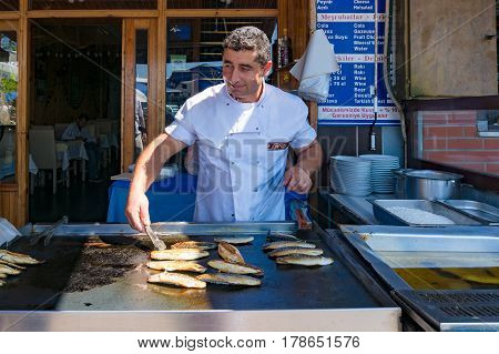 Street Food Vendor Cooking Fish