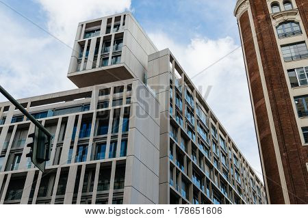Madrid Spain - September 18 2016: Low angle view of modern and old buildings at Gran Via Street in Madrid. It is an important street in Central Madrid with shops and theaters.